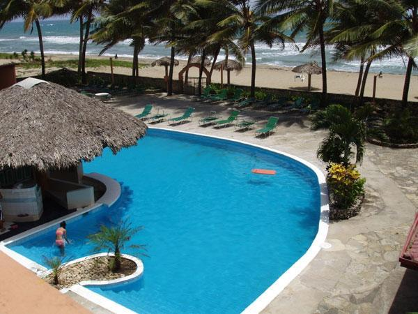 OVER VIEW OF POOL / BEACH - CARIBBEAN BEACHFRONT CONDO ONLY $1500 PER MONTH !! - Cabarete - rentals