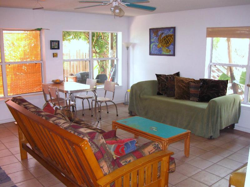 Our comfy lounge...overlooking the private and lush backyard. - Beach Combers Bungalow - South Padre Island - rentals