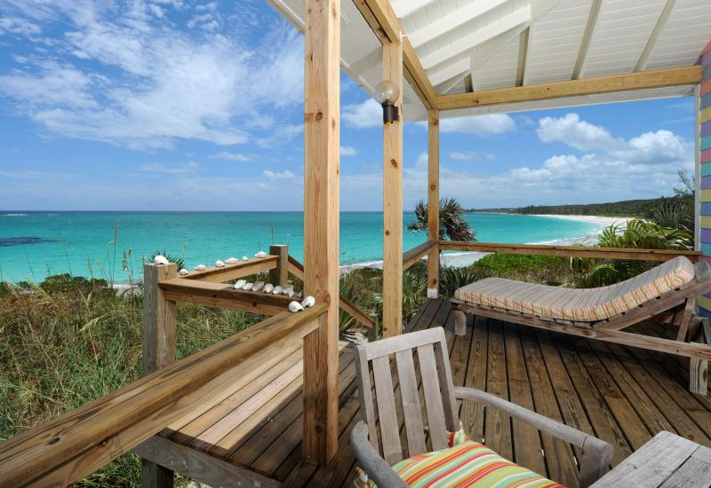 Outdoor dining and lounging deck on the surfside in your one bedroom beach house for 2 people! - Cayo Loco Atlantic Eleuthera Honeymoon Beachfront Romantic PinkSand Beach Houses - Governor's Harbour - rentals