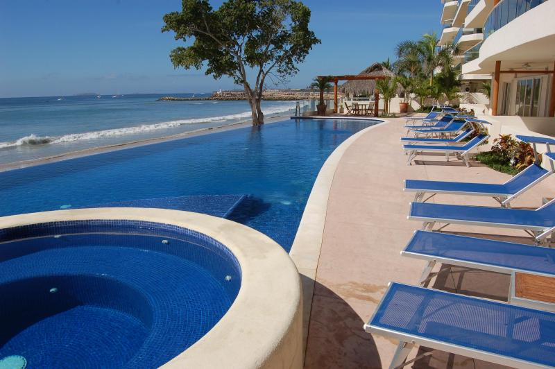 Our large and lovely infinity pool! - El Faro Three Bedroom Condo in Punta Mita - Punta de Mita - rentals