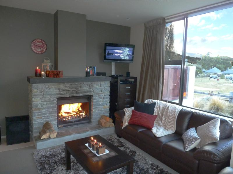 cosy lounge with fire - Cardrona Sanctuary - A little Piece of Paradise - Wanaka - rentals