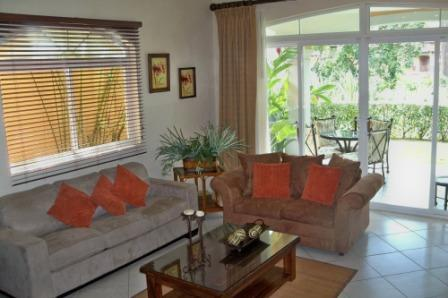 Living room with TV , Stereo, DVD and convertible sofa - Los Suenos Resort DELUXE 2 BDR Condo - Puntarenas - rentals