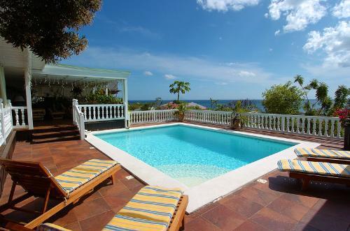Sapphire....Pelican Key, Dutch St. Maarten - SAPPHIRE...  a casual hillside 3 BR villa, St Maarten villa with ocean views in - Pelican Key - rentals