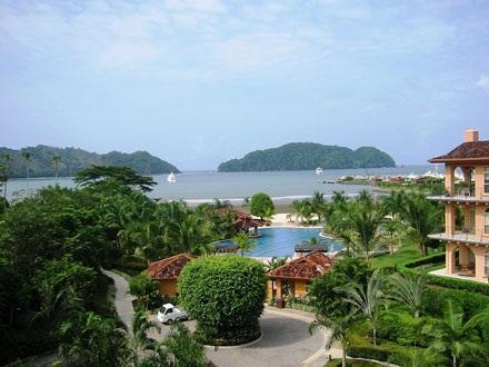 View from deck overlooking the Beach Club pool - Luxury Ocean view condo in Los Suenos, Costa Rica - Los Suenos - rentals