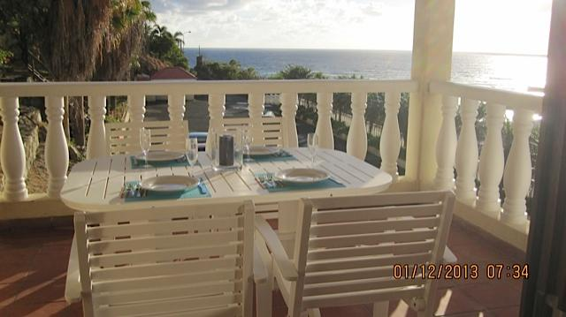 Dinning on our balconey views to St.Barts - Saint Martin Luxury Condo, Dawn Beach Ocean Views - Philipsburg - rentals