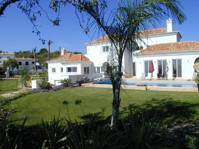 View from front garden to main house across pool - Luxury 5 bed villa overlooking Quinta do Lago - Almancil - rentals
