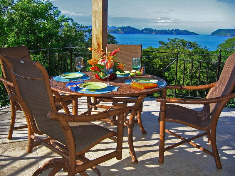 Dining on the Veranda overlooking Flamingo Bay - Beautiful Oceanside Home with Gorgeous Ocean Views - Playa Potrero - rentals