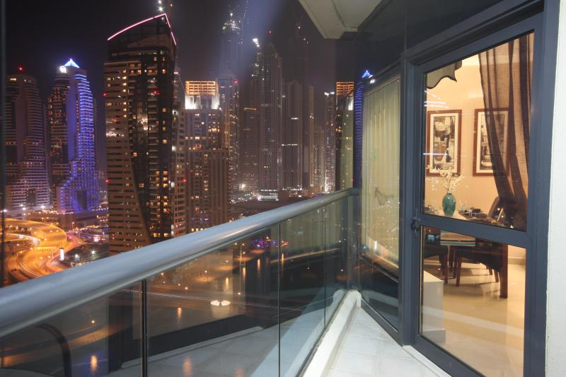 The balcony at night with views over the Marina and the Ocean - 5 mins Metro  Mall, Beach and Restaurants sleeps 6 - Dubai - rentals