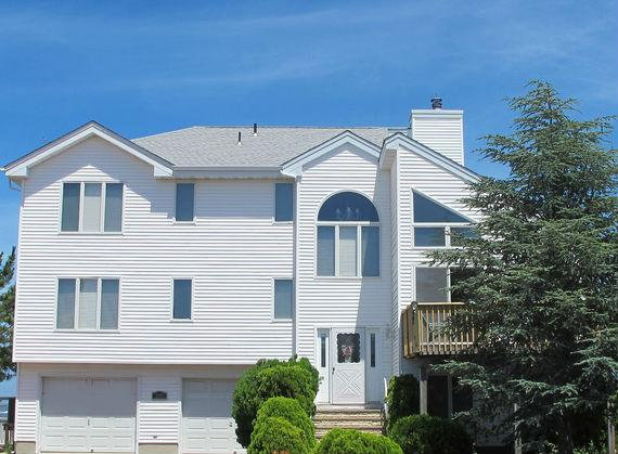 CausewayView Front of the house - Luxury Modern Bay Front Custom Home - Pier for Boat - Manahawkin - rentals