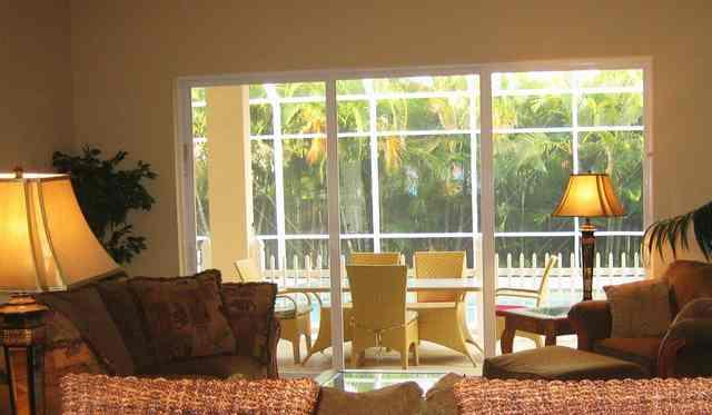 Family room overlooking lanai and pool - Beautiful!  4 Br, few blocks to BEACH - Naples - rentals