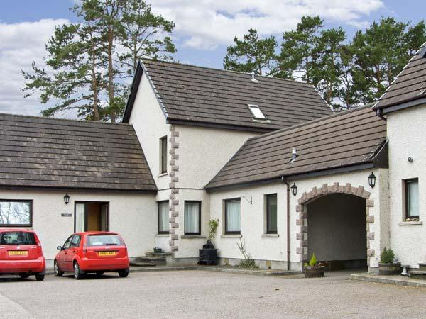 THE COACH HOUSE, family friendly, country holiday cottage, with a garden in Newtonmore, Ref 5196 - Image 1 - Newtonmore - rentals