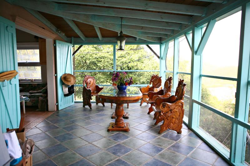 Porch over looking ocean of hurricane hole and east end of St. John beautiful wind  - Honeymoon Hikers Cottage- Coral Bay,USVI- St. John - Coral Bay - rentals