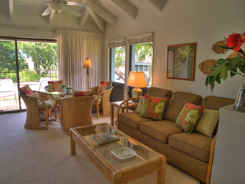 Lovely open living room/dining area with ocean view off the lanai - Inviting Ocean View Condo in Poipu, Kauai - Poipu - rentals