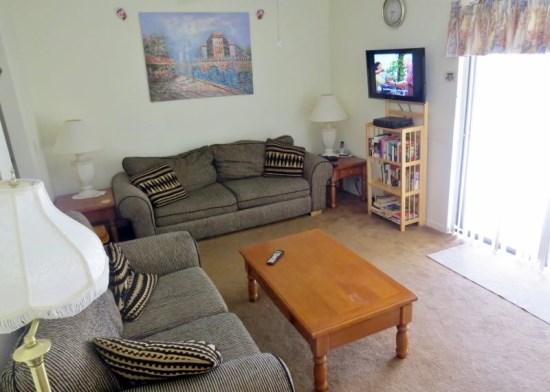 Living room with flat screen cable TV, wifi - Affordable Home with Private Pool - Poinciana - rentals