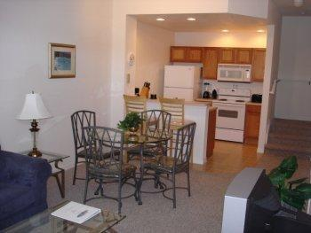 Open plan living, dining and kitchen - Fountain View Villa Venetian Bay Vacation Rental Townhouse - Kissimmee - rentals