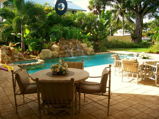2 Rock waterfalls cascading into our heated pool and spa - Tropical Paradise  Home With Yacht Cruise - Fort Lauderdale - rentals
