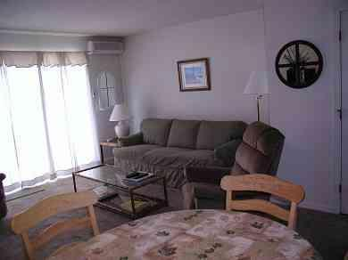 Living Rm with sleep sofa and sliding door to patio - Ocean Edge 2 BR Townhse  A/C,Pools,Great Yard,WiFi - Brewster - rentals