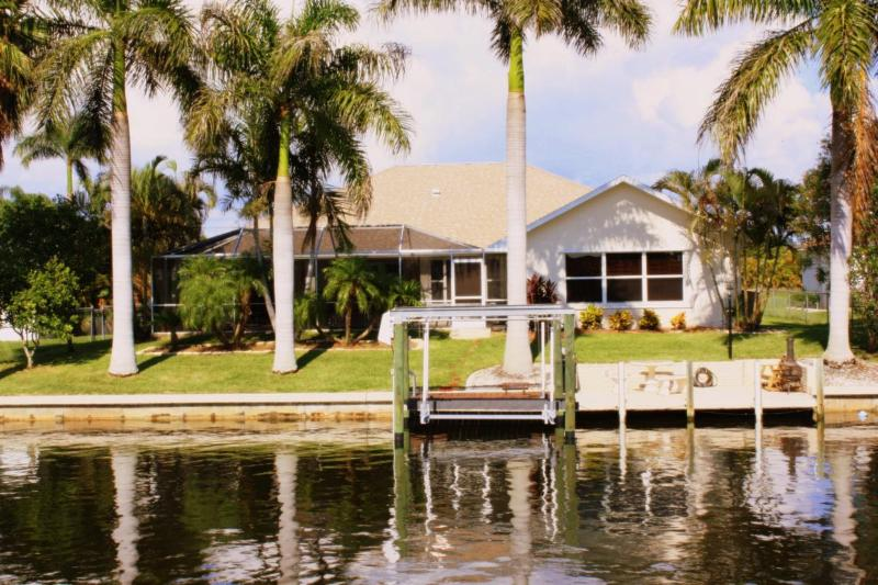 Canal View of Backyard with Mature Royal Palms Lining Seawall - Waterfront with a Private Pool - Award Winning* Gulf Access Pool Home-Secluded Area - Cape Coral - rentals