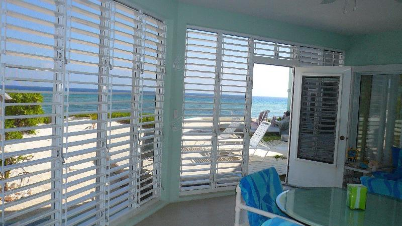 Spacious Lanai opening to your private deck set upon the white sand beach - Beachfront ground floor condo rental The Laurelei - Grand Cayman - rentals