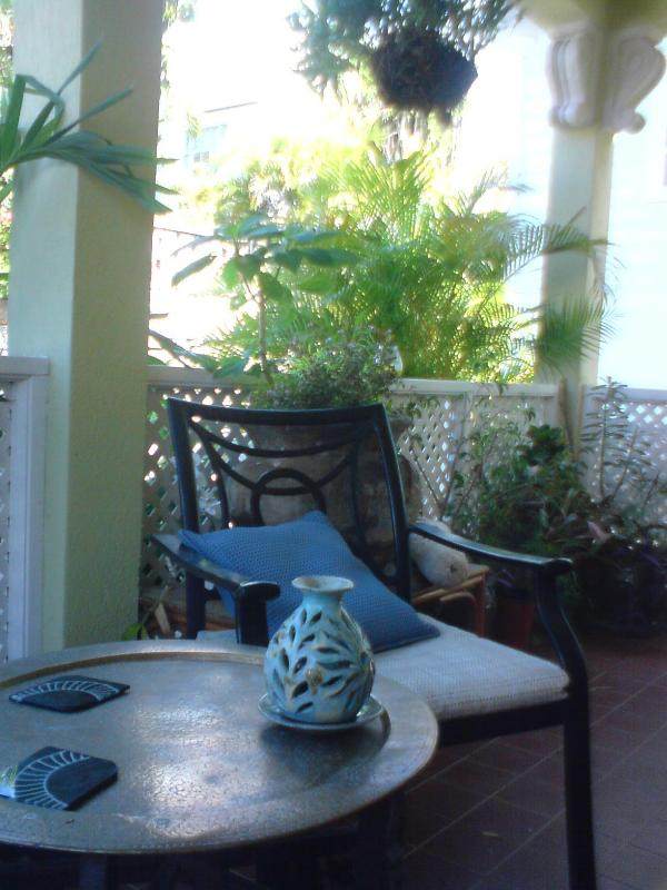 Sunbeams Entrance Patio - SUNBEAMS - CHARMING GARDEN APARTMENT - Paynes Bay - rentals