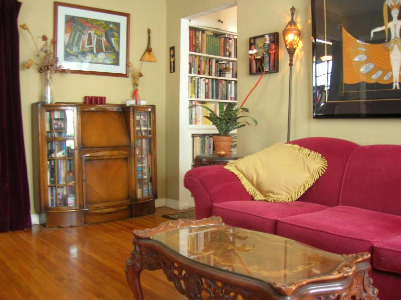 Living Room with Antique Sofa, Deco Art, Secretary Desk - Art Deco Hollywood Bungalow - Los Angeles - rentals