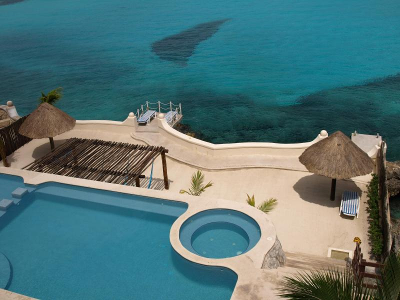 View from our balcony. Pool Sand and Sea. - Stunning 2BR Condo in Rare, Private Ocean Setting - Cozumel - rentals