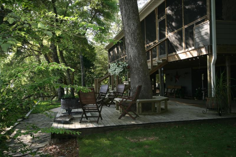 Deck of the main lodge.....a beautiful place to sit and enjoy the river and fire in the fire pit - Choctaw Lodge Retreat - Destin - rentals