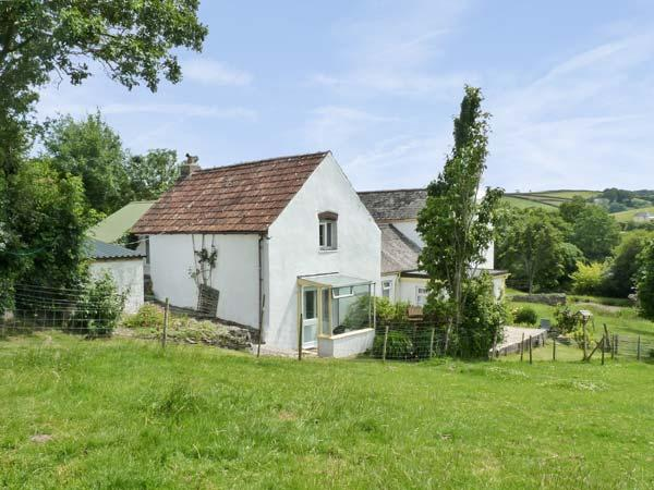 THE COTTAGE, pet friendly, country holiday cottage, with a garden in Parkham, Ref 8839 - Image 1 - Bideford - rentals