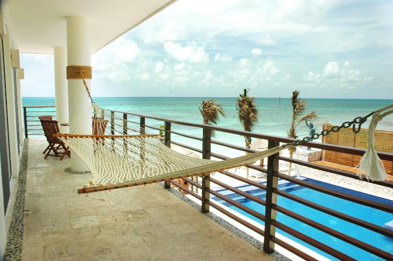 Hammock on terrace overlooking Pool and Sea. - Luxurious Beachfront Condo on the Riviera Maya - Puerto Morelos - rentals