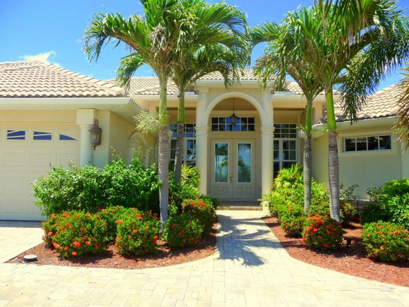 Front of home with Triple Car Garage & circular driveway - Huge Luxury Direct Gulf Access Home w/Pool & Spa - Cape Coral - rentals
