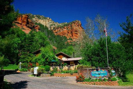 As you drive up Oak Creek Canyon, we are located against the red rocks in a parklike setting. - The Canyon Wren Cabins - Sedona - rentals