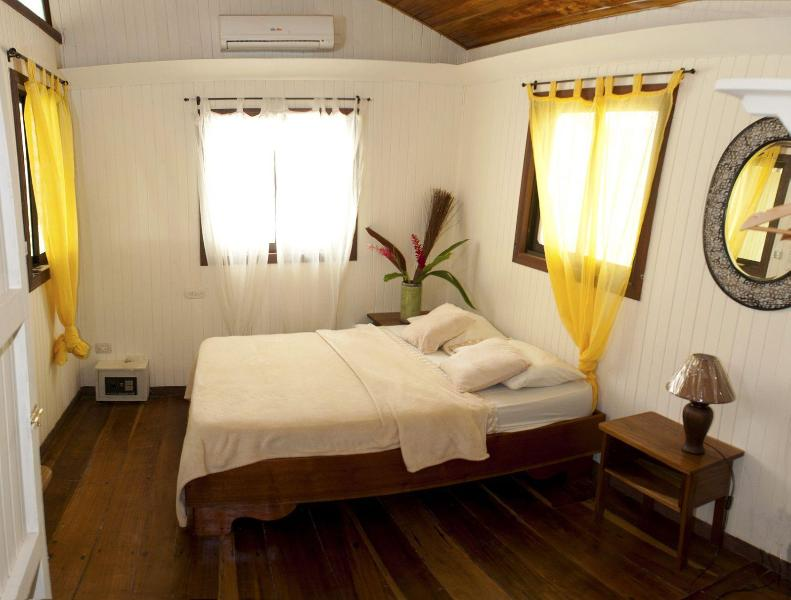 Bedrooms have quiet air conditioning, iPod players and safes for valuables. - Beachfront Punta Uva: Storied Home, Modern Comfort - Punta Uva - rentals