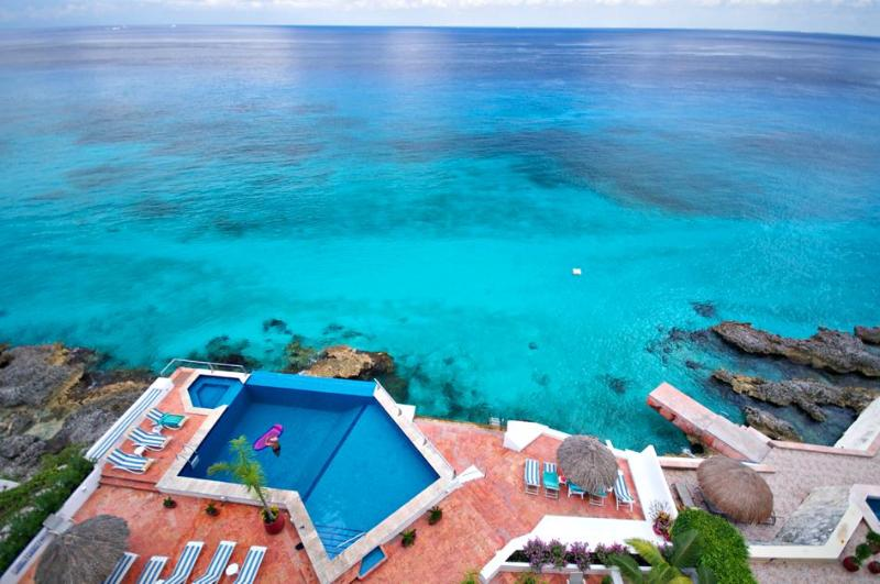 Balcony view - MAGNIFICENT OCEAN VIEWS! Puesta del Sol Phase 2, CONDO# 6 North - Cozumel - rentals