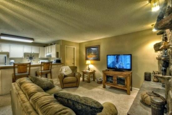 Living Area With Gas Fireplace and Flat Screen TV - Storm Meadows E23 - Steamboat Springs - rentals