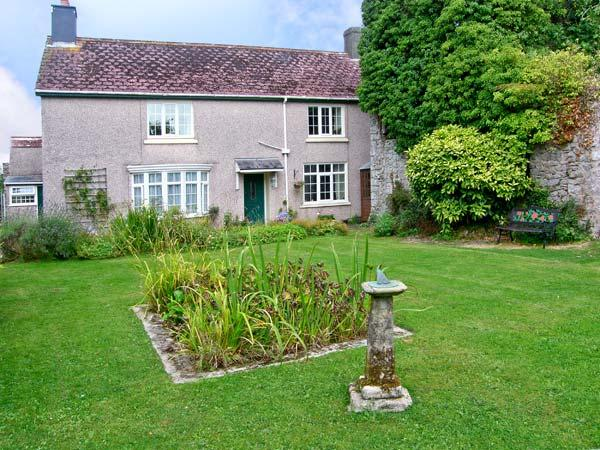 THE OLD MANOR HOUSE, pet friendly, character holiday cottage, with a garden in Pembroke, Ref 9948 - Image 1 - Pembroke - rentals