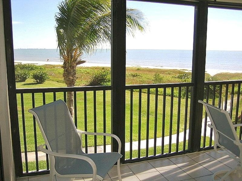 Beach View From Lanai - Relax and Enjoy Your Morning Coffee or Afternoon Drink. - Sanibel Surf Sounds & Beachfront View, Bikes/Wifi - Sanibel Island - rentals