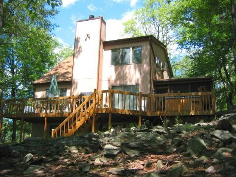 Rear view of house, large deck with hot tub and screened in porch - Outdoor Hot Tub, Gameroom, Walk to Skiing + Pools - Bushkill - rentals