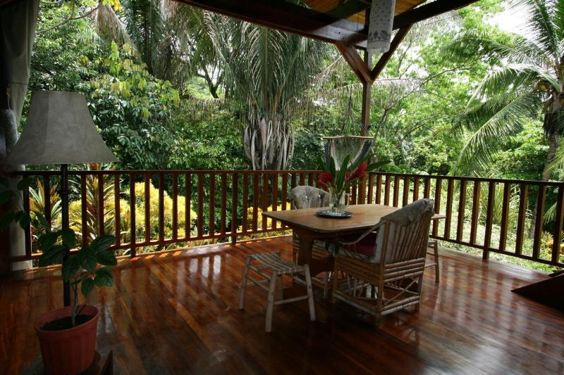 Feel the stress melt away as you relax on this deck- at eye level with monkeys and tropical birds. - Casa Montezuma - Steps to the Beach, Private, Safe - Montezuma - rentals