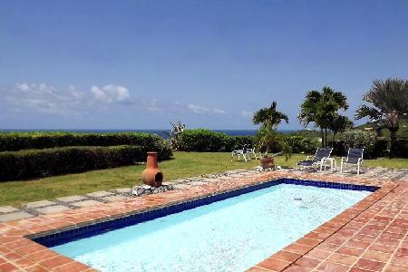 West Indian style Caribbean Pearl villa on one level with A/C,  large outdoor area & pool - Image 1 - Saint Croix - rentals