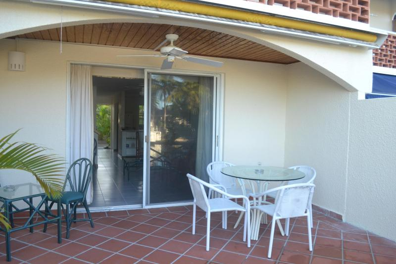 Patio overlooking the waterway - Sea Breeze, 243E South Finger, Jolly Harbour - Jolly Harbour - rentals