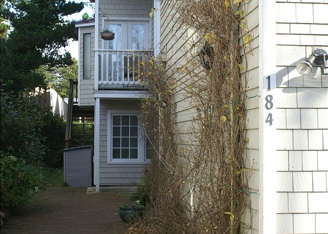 The Courtyard entrance tucked behind garage with privacy from the street - COURTYARD Both  ~ SPACIOUS HOME WITH HOT TUB in the Heart of MANZANITA OREGON - Manzanita - rentals