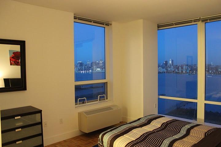 2 Bedroom Suite Facing New York City!! - Image 1 - Jersey City - rentals