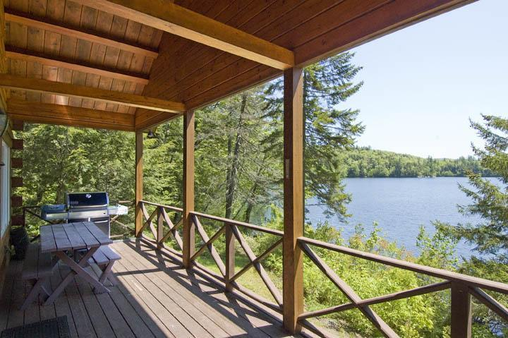 Large open deck area, with a Weber grill and the best views of the lake. - Beautiful Waterfront Log Cabin - White Mountains - White Mountains - rentals