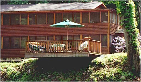 View of the Lodge from across the river - Cheat River Lodge WATERFRONT private entrance & bath. Pet friendly. HOT TUB! - Elkins - rentals