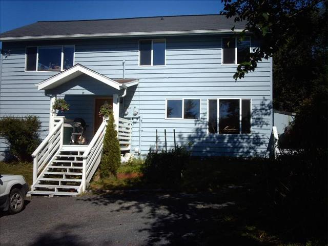 Front of house, Apartment entry is at the right end - Above The Rocks - Sitka - rentals