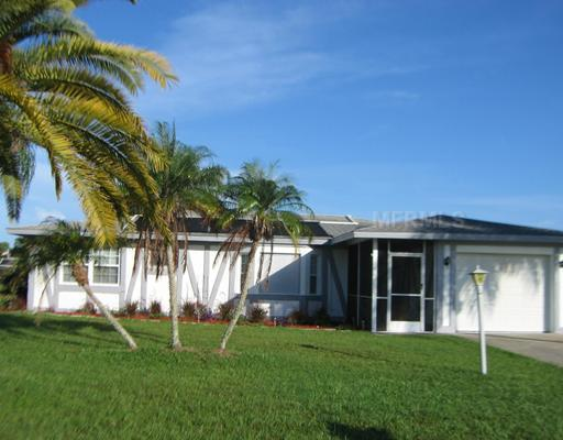 exterior front - vacant lots either side for extra privacy - Affordable Comfort!  Pool Home on Freshwater Canal - Rotonda West - rentals