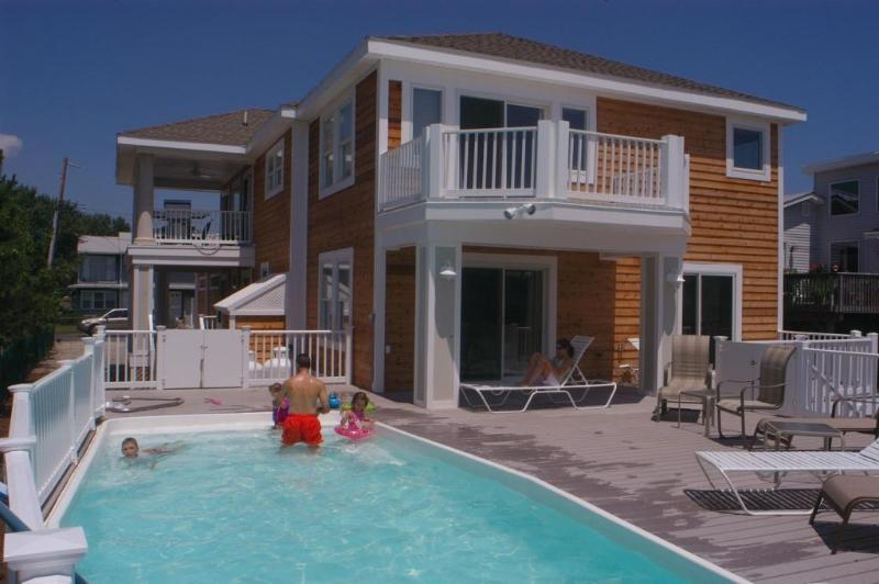 Private heated pool, large deck around it and views of the bay.  Hot but is adjacent. - Walk to Beach, Pool,Hot Tub, Incredible WaterViews - Fenwick Island - rentals