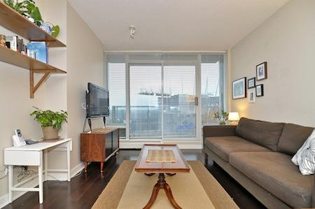 The living room with access to a small balcony. - Downtown Vancouver 1 Bedroom Condo Steps to Attractions and Amenities - Vancouver - rentals