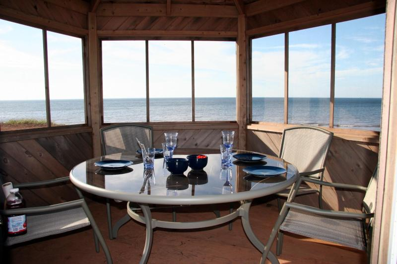table set for sunset dinner in the gazebo - Garnet Shores Beach House PEI Prince Edward Island - Savage Harbour - rentals