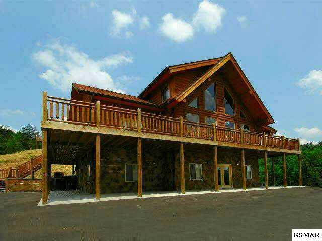 Beautiful wall of glass - 4 Bedroom  Log Cabin w/game room & Theater room - Sevierville - rentals